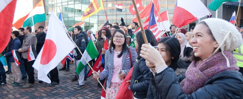 Students parading with flags
