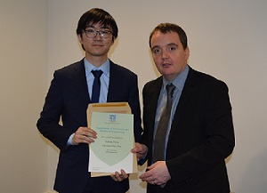 Picture of Yafeng Zhang receiving his award from Professor Geraint Jewell