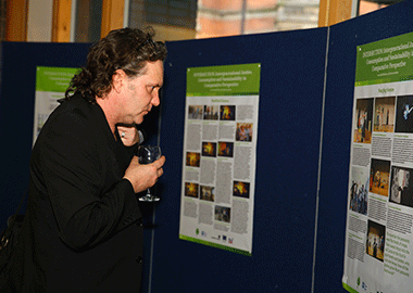 Man looking at Sustainability Dancer poster
