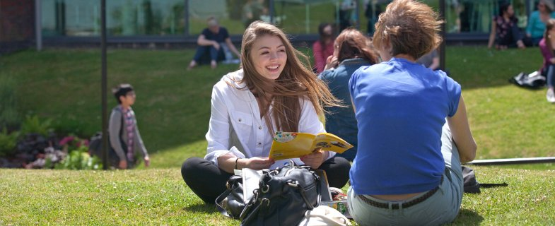 Undergraduates on grass outside Students' Union