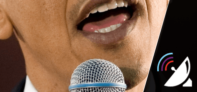 President Obama speaking into a microphone