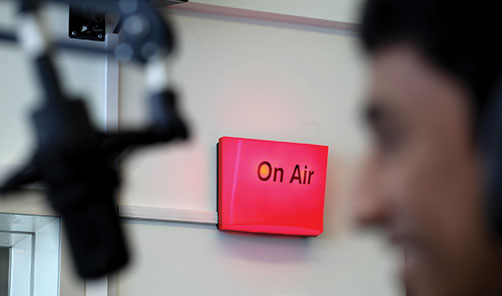 Student, microphone and on air sign