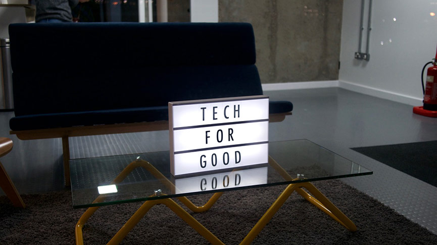 Tech for good sign on table. Image courtesy of Yoomee