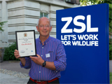 Professor Tim Birkhead with his award from the ZSL