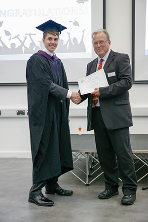 Peter Worsley being awarded the Douglas Lewin Memorial Award by the Head of Department