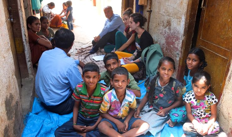 Image of Children in Slums with Researchers
