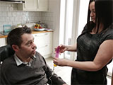 MND patient Jason and his wife Liz using a feeding tube