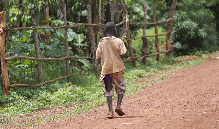 Photo of boy walking in Africa