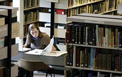 photo of woman studying in library