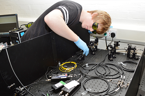 Chris O'Rourke at work in the Quantum Information Laboratory