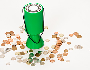 Charity box surrounded by coins