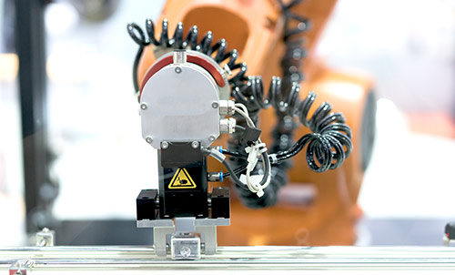 Automatic robot arm with imaging sensor in assembly line working in factory