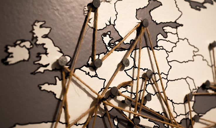 Map of Europe linked by pins