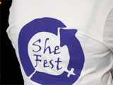 A tshirt with the SheFest logo on it