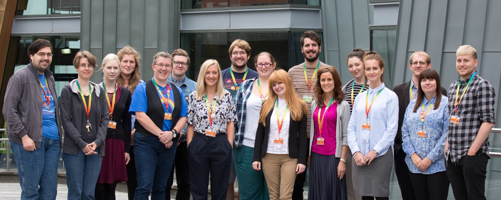 Staff wearing our rainbow lanyard in support of workplace equality