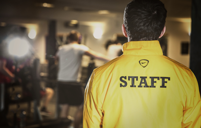 A picture of a staff member from behind and over their shoulder.