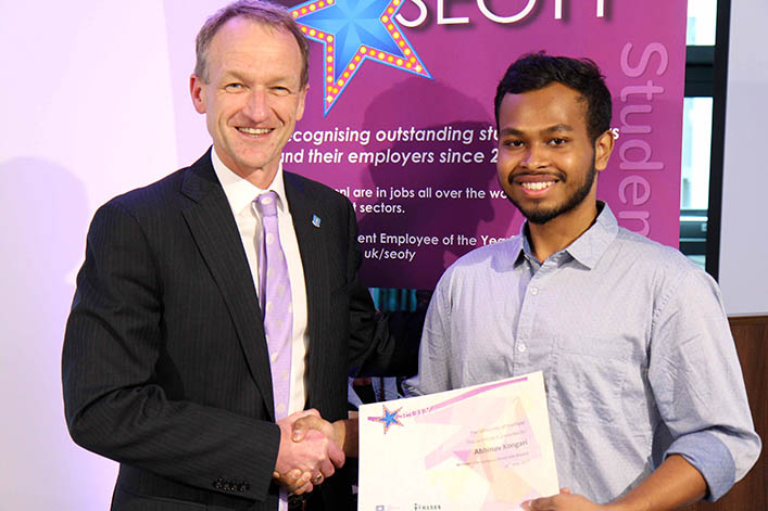 Student Employee receiving his award from Professor Wyn Morgan.