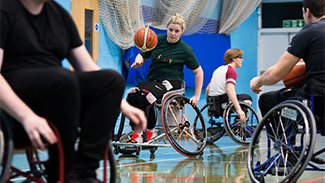 Picture showing wheelchair basketball in action.