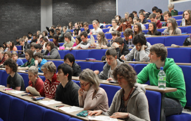 Students in a lecture hall listening to a lecture