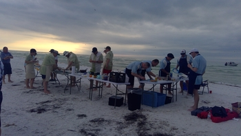 Members of the group enjoying food on the beach