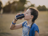 A child drinking a fizzy drink