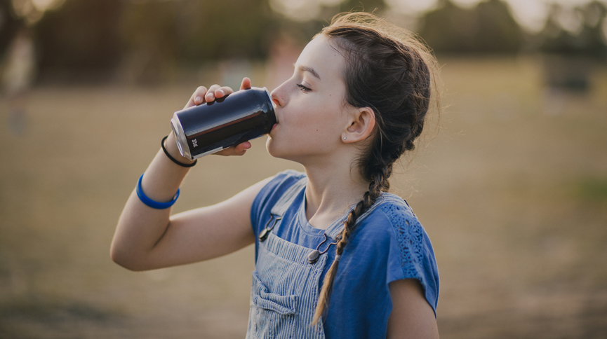 Image of girl drinking sugary drink