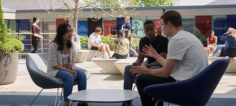 Students meeting in the Management Shool courtyard