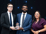 Máté Lukács and Dhilan Devadasan receive their Student Employee of the Year award