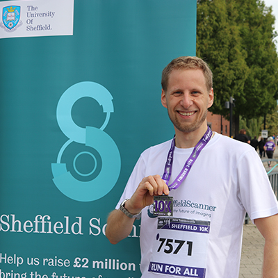 Chris Varnom with his medal after completing the Sheffield 10K 2018