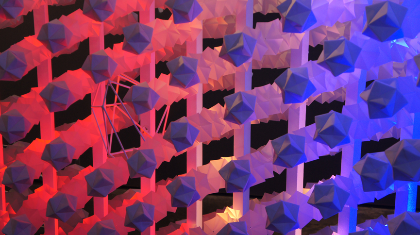 Red, blue and purple lights that are part of the Metabolon exhibition