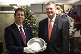 Dr Jeff Wadsworth receives a pewter bowl from Prof Koen Lamberts