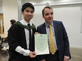 Picture of Lap Fong receiving the David Howe Prize