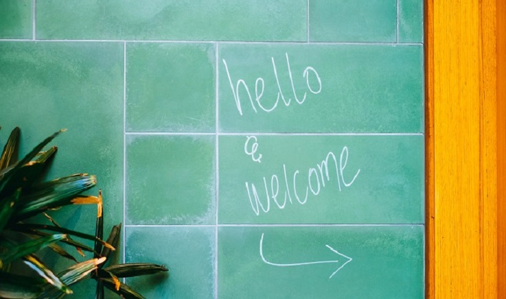 Hello and welcome written on a blackboard