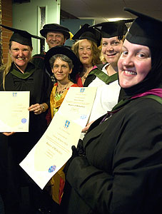 MMid Gradutes with their degree certificates