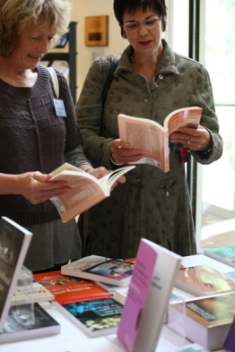 Photograph of Student and Tutor looking at text books