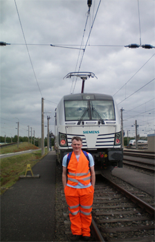 Professor Roger Lewis from the University of Sheffield standing next to a train