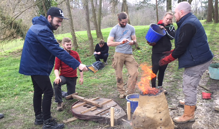 Students building iron furnace