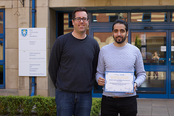 Phil McMinn and Ibrahim Althomali with award for IEEE distinguished paper