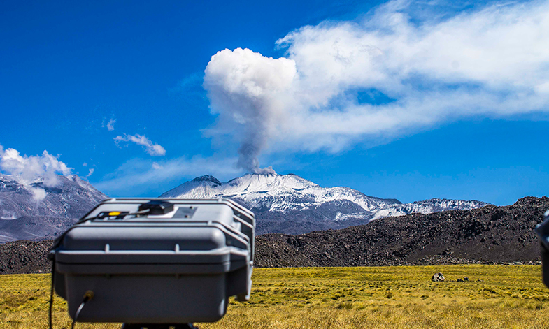 Volcano monitor in front of volcano