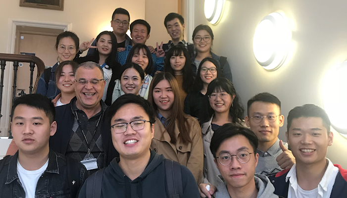 Photo of Weisheng Xiao with his English language class at the University of Sheffield