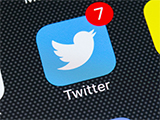 The Twitter icon on a smartphone