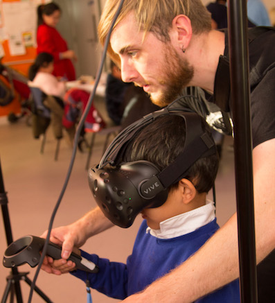 Photograph of child using VR equipment