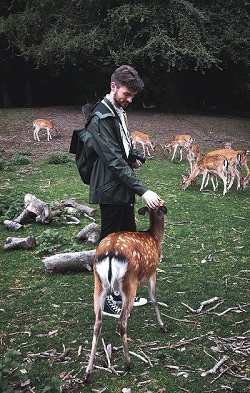 Student with deer in Denmark