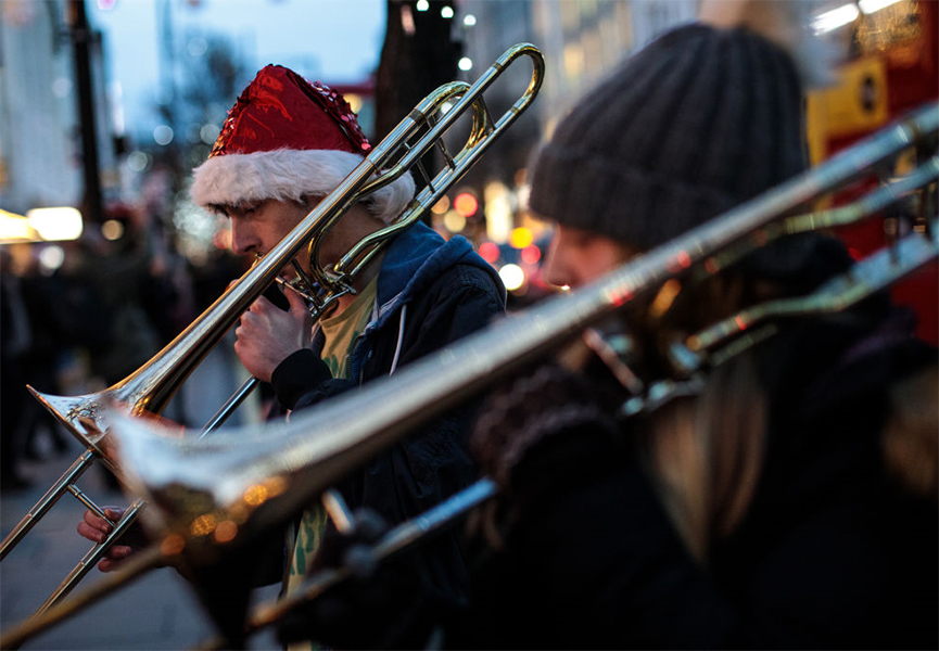 People playing in a brass band on London's Oxford Street