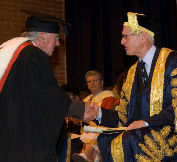 Dr receives his degree from the Chancellor