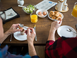 Older people eating breakfast