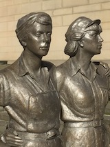 A view of the top half of the bronze sculpture of two of Sheffield's women of steel