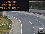 Motorway sign advising against non-essential travel