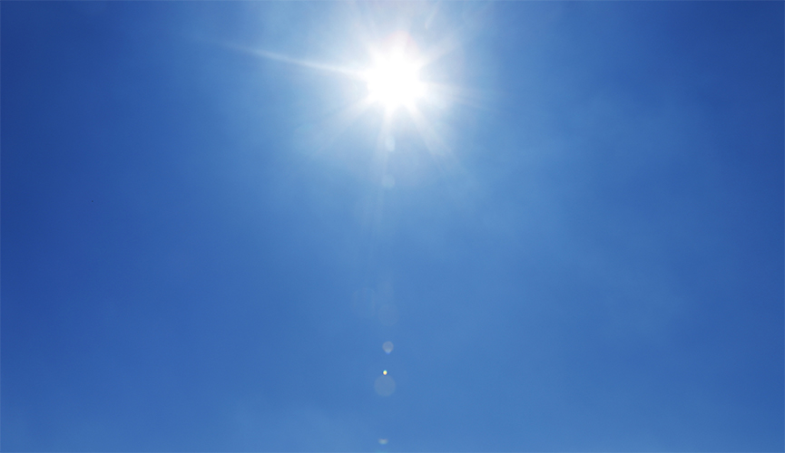 The sun in a blue sky with no clouds