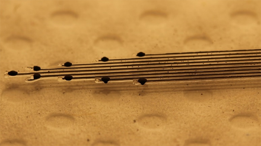 A close up shot of a neural implant on a surface
